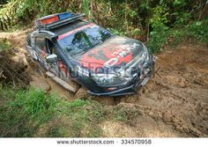 Tenom Sabah, Malaysia - Oct 26, 2015:An extreme 4X4 car passing a muddy trail of jungle route in the rainforest of Sabah Malaysian Borneo.Sabah jungle is popular for 4X4 adventures.