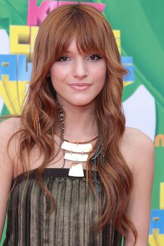 i don't know who this is (bella thorne, apparently??) but i saw her feather hair extensions and thought of you, shirley!