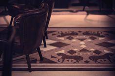 CAFE REITSCHULE MÜNCHEN. design by NOVONO. custom patterns for printed rugs.  beige. elegance.