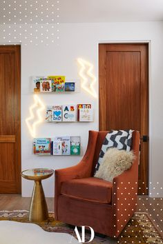 The singer and her husband, Evan Ross, used midcentury-inspired furniture and hues of rust for a space their new baby can grow into. The couple leaned into the bohemian and eclectic vibe they have going on through the rest of their home to bring the nursery to life 😍 #chair #plush #pillow #rig #sidetable #books #wood #doors #lights Potter Barn Kids, Evan Ross, Faux Sheepskin Rug, Bohemian Nursery, Ashlee Simpson, Nursery Design, Nursery Decor, Nursery Neutral, Wood Pieces