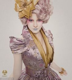 Effie's outfits, reflecting the sartorial inclinations of Capitol residents, conjure images of a modern Marie Antoinette with large, colorful wigs and exaggerated proportions. Makovsky's designs for the film pull from various eras and influences, including modern-day runway shows from the house of Alexander McQueen, creations by John Galliano, vintage milliners and Elsa Shiaparelli, a designer known for her surrealist visions and partnerships with artists such as Salvador Dali.