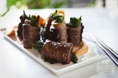 Bite-sized flavor comes wrapped and seared with scallions and sweet teriyaki sauce. Beef Negimaki is a great grab and go recipe for big holiday entertaining or for nibbling when you're toasting with friends. It goes perfectly with a variety of appetizers or a Japanese -inspired feast at home.