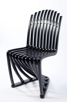 Stripe Chair Design by Joachim King. Although it shares a similar form with the classic Panton Chair, instead of being made from plastic, the swept curves of this chair are made by building it up in several layers, each cut from birch plywood using CNC cutting technology.