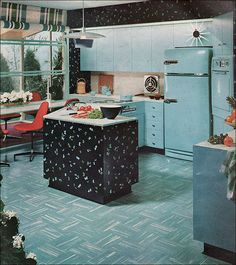 1955 Powhatan Turquoise Kitchen    That was the name of the shade of Armstrong linoleum in this kitchen. This must have made quite the statement ... every other ad seemed to be pink! Just a bit of red to make it pop.