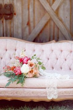 love the contrast of the rough shabby wood backdrop and the elegant sofa