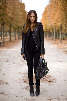 You cannot go wrong with an all black outfit, as demonstrated by Caroline Blomst in this striking composition of leather jacket and skinny black jeans. Pair this look with leather accessories and boots to capture Caroline's rocker girl style. Brands not specified.