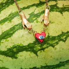 The Sacred Heart necklace. A reminder that when they go low you can go high  photo by @palora