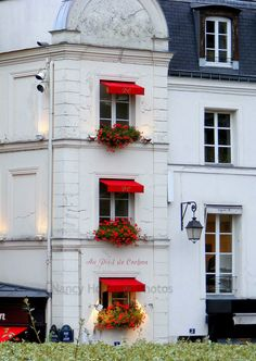 I like the combination of the red awning against the white with the iron lantern.