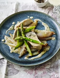 Chicken with cream sauce and fresh asparagus is the classiest family dinner we know.