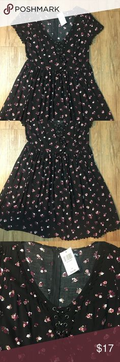 Hot topic fit and flare black with roses This dress is super cute and feminine.  It is new with tags and is 100% rayon. It has a little tie on the bust.  The waist is elastic but the rest of the dress does not provide stretch.  Feel free to ask questions. Hot Topic Dresses