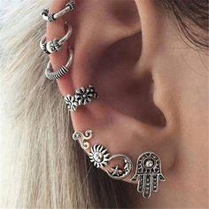 Accumulation de boucles d'oreilles inspiration bijoux bohème https://www.mytrendymood.com/nouveautes/839-lot-de-boucles-d-oreilles-argente.html