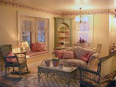 Chintz ware (from a Lori Potts kit), a Hank and Eleanor Taylor hutch, and a casual seating area with wicker by Barbara Tate. The rug is from McBay Miniatures.