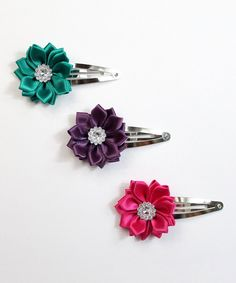 Take a look at this Teal, Plum & Hot Pink Floral Clip Set today!