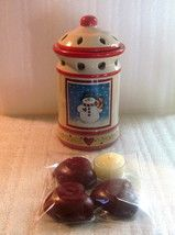 Dianna Marcum Ceramic Snowman Oil or Wax Tart Warmer  Color: Tan, Red, and Green  Pattern: Country Snowman  Product Description:  Give the gift of fragrance with this festive holiday tealight warmer. Made from ceramic and painted with a country style theme, and snowman. Measures 7 inches tall by 3.75 inches wide. Non-electric, uses tea lights to warm the wax or oil placed in the top section. 2 pc unit, includes 3 heart shaped tarts and one tea light.