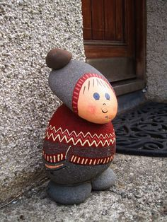 Cutest doorstop gnome Completely Icelandic, down to the traditional patterning of the Icelandic woolen jumper and volcanic rock. They didn't have any banker gnomes getting put into gnome jail though. Stone Crafts, Rock Crafts, Crafts To Make, Fun Crafts, Crafts For Kids, Arts And Crafts, Crafts With Rocks, Family Crafts, Pebble Painting