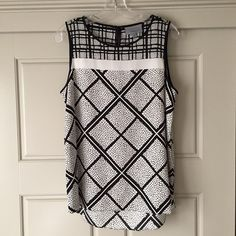 Silk Top Black and white patterned classiques entier silk sleeveless top. New without tags. Bought from Nordstrom last spring. Never worn! Save over 100$ compared to retail price. Classiques Entier Tops Tank Tops