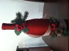 This one is a wine bottle wrapped in yarn with some christmas decor!