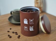 coffee tin with owl illustration