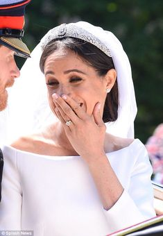 After the nerves of the wedding service, Meghan looked relaxed and happy as the carriage p...