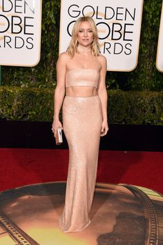 Kate Hudson in a Michael Kors Collection dress, Forevermark jewelry, and Jimmy Choo bag