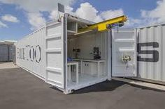 shipping container garage at DuckDuckGo Shipping Container Rental, Shipping Container Workshop, Cargo Container Homes, Container Shop, Containers For Sale, Storage Container Homes, Container Cabin, Container Buildings, Container House Design