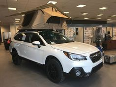 Custom Subaru Outback on the showroom floor! Subaru Outback 2015, Subaru Outback Offroad, Wrx Sti, Impreza, Subaru Outback Accessories, Colin Mcrae, Toyota C Hr, Off Road Camper, Roof Top Tent
