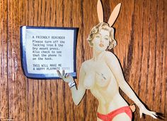 A topless Playboy Bunny picture holds up a note asking guests and residents to make sure t...