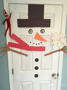 Elf Puts Snowman on Door THE BEST COLLECTION OF ELF ON THE SHELF IDEAS https://www.mamacheaps.com/elf-on-the-shelf-ideas