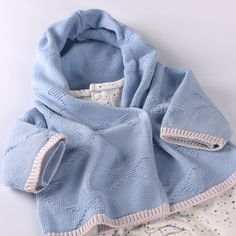 A perfect gift for baby's first Christmas. A beautiful and practical baby boy's pure cotton knitted hooded shalw cardigan with cute star pattern.Matching Star Blankets and Hats are also available.Designed in the uk around Newborn Principles, precious, practical, soft and comfortable, our Star Hooded Shawl Cardigan is a must have for your little one! A stylish yet practical layering piece, the wide hood gently protects your little one acting like a shawl while the simple one popper…