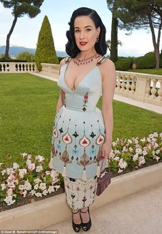Quirky retro glamour: Dita Von Teese donned a bizarre lamp shade-looking dress, featuring ...