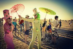 Rainbows and parasols in the Tankwa Desert, South Africa - AfrikaBurn by Africa_Geographic, via Flickr