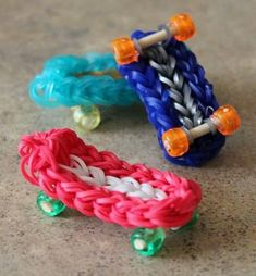 Skateboard Rainbow Loom Charm. Rainbow Loom is a plastic loom used to weave colorful rubber bands into bracelets and charms. It is one of the top gifts for kids.