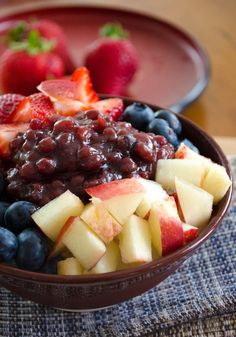 Patbingsu; Korean shaved ice dessert. this one looks yummier than the ghetto one I made with crushed ice from the fridge dispenser, milk, and mango................... why