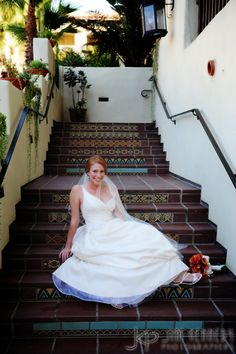 Beautiful bride on staircase at Estancia La Jolla Hotel | Jim Kennedy Photographers