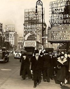 Times Square.. Circle Chevrolet-Planters Peanuts-Pause Coca-Cola..1937.. Go West Young Man.. 1936