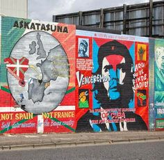 The Solidarity Wall on the Falls Road in West Belfast, Northern Ireland. The mural on the right is showing solidarity with Cuba while the mural on the left is supporting Basque Separatists.