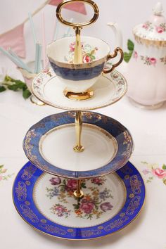 This rich and vibrant 3 tier Madhatter dessert stand/cake stand / cupcake display is made from bone china. The top tier is such a pretty cup and saucer, teamed with the middle and base plate make it so special.   Take your time and enjoy a leisurely tea with delicious fancy cakes and sandwiches and savour every mouthful.  When not in use at the tea table use it for fruit or in the bedroom for your jewellery. The listing is for one cake stand and shipping in the UK will be less than ...
