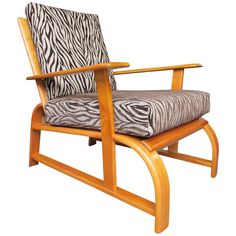 Streamline Modern Lounge Chair in the Manner of Gilbert Rohde | From a unique collection of antique and modern lounge chairs at https://www.1stdibs.com/furniture/seating/lounge-chairs/