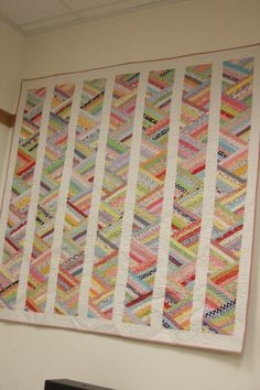 Scrappy Quilts - it's called Optical Illusions from a book Strip Pieced Quilts. Someone said you sew strips together and cut 60 degree angles. Then I think you sew them together into a strip, then sash between. Good use of scraps