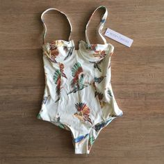 Boys and Arrows one piece suit  Boys and Arrows one piece suit. Looking for an amazing gift or a stunner for your getaway? This suit is beautiful in design, print and cut. Listed as Acacia for views. ♏️ercari listing for better price. acacia swimwear Swim Bikinis