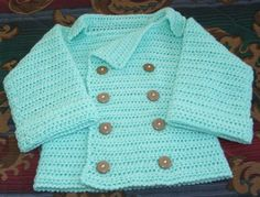 "Size 12 months: Chest-20"", Back, neck to bottom of sweater-11"", Back, shoulder to shoulder-9"", Sleeve-at shoulder seam 8"" plus cuff  Made in one piece, no sew-except for but..."