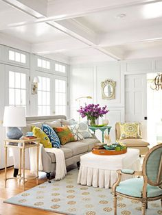 I love this white space, hit with saturated pops of color. Especially loving the spotted rug! #personalstyle #decorating