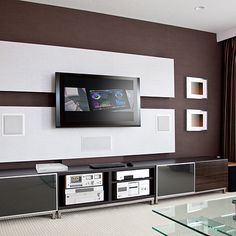 Photo about Modern Home Theater Room Interior with Flat Screen TV, brown wall. Image of furnished, furniture, home - 31863397 Hide Tv Wires, Hide Cables, Home Entertainment, Entertainment Centers, Installation Home Cinema, Home Cinema Systems, Modern Tv Wall Units, Muebles Living, Ideas Hogar