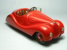 By Schuco Modell, a German toy maker founded in 1912. The company's specialty was diecast cars and trucks in tin and plastic.