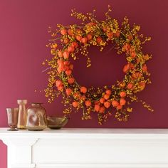Brighten up an entryway or a blank wall with a cheery fall wreath, made from bittersweet and Chinese lanterns.