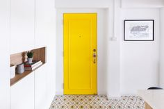 Peek into an Aussie-Inspired HDB, Complete with Local Twists - this is the entryway with a bright yellow door to greet the guests Black Interior Doors, Yellow Interior, Interior Design Singapore, Interior Design Services, Shoe Cabinet Design, Creating An Entryway, Yellow Doors, Concept Home, Open Concept