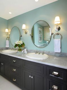 This bathroom offers generous space without going overboard on square footage. The homeowners chose a large double vanity featuring marble countertops and vanity lighting.