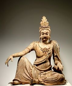 Bodhisattva Avalokiteshvara in Water Moon Form (Shuiyue Guanyin 水月觀音菩薩), 11th century, Liao dynasty (907–1125). The posture is a depiction of the divinity in his Pure Land, known as Mount Potalaka, originally thought to be located on an island somewhere south of India. By the Ming dynasty, this mythical paradise had been identified with Mount Putuo, an island off the east coast province of Zhejiangis, and had become an important pilgrimage site.