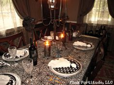 Halloween Tablescape with Skulls and Spiders by coconutheadsurvivalguide.com