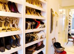 White wall sized shoe and purse rack in Laura Garcia's walk in closet in her NYC apartment